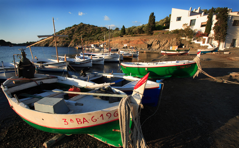 Fishing boats on the shores of Port Lligat. Salvador Dalí's home can be seen in the far right and was built from a series of restored fishing huts.  Photo by Robert J. Brodey